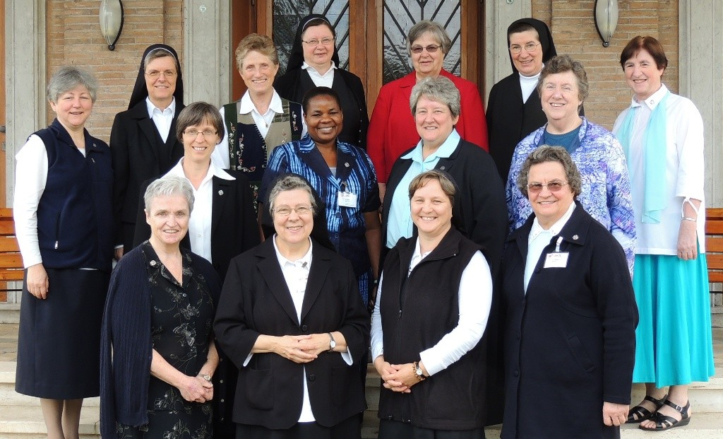 The members of the 11th Extended General Council: Front row: Sister Maureen McGoey, Schwester M. Beatrix Mayrhofer (ÖR-IT, includes CE), Sestra M. Magda Burger (SI), Irmã Cecilia Martinello (ALC) Middle row: Lobmayer M. Judit növér (MG), Sister Joyce Nyakwama (AF), Sister Mary Maher, Sister Mary Anne Owens (CP) Back row: Irmã Inês Camiran, Schwester M. Charlotte Oerthel (BY), Sister Carol Jean Dust, Schwester M. Dominica Michalke, Sister Kathleen Cornell (AM), Siostra M. Irenea Książak (PO), Irmã Vitória Marques.